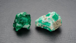 Raw Muzo and Chivor emeralds by GIA Robert Weldon