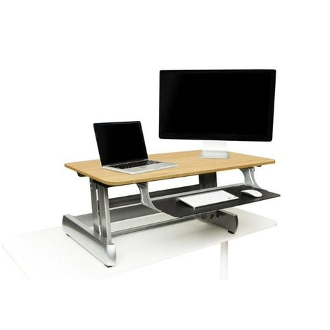 InMovement Standing Desk Converter light wood with laptop and monitor
