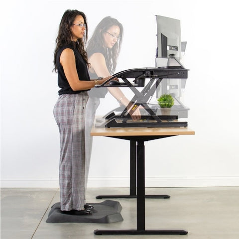 Vivo Desk-V000R 36_ Black Standing Desk Riser In Motion
