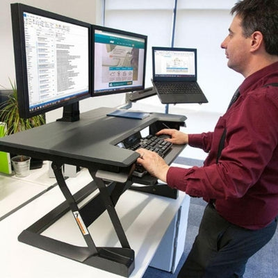 Ergotron WorkFit T Sit Stand Desktop Workstation Front Side View Standing