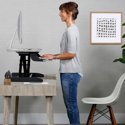 Ergotron WorkFit Z Mini Sit Stand Desktop Side View Standing