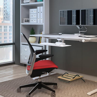 Humanscale FM100 Foot Rest With Red Chair