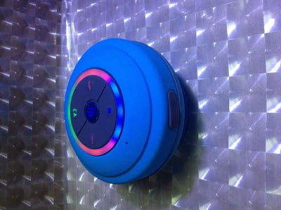 blue wireless shower speaker with fm radio
