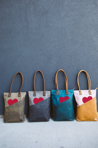 tall totes in four color ways with hearts in open outside pockets