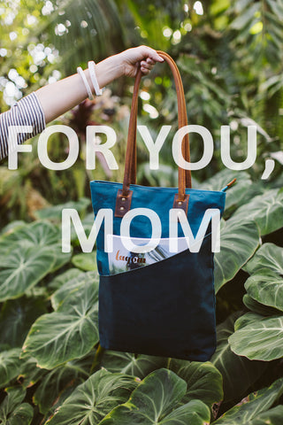 Perfect Mother's Day Gift: Waxed Canvas Tall Tote in Dark Teal with Handy Outside Pocket, greenery beyond