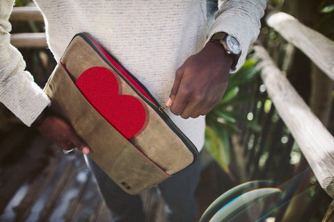 laptop sleeve in earth color way with heart in outside pocket red interior