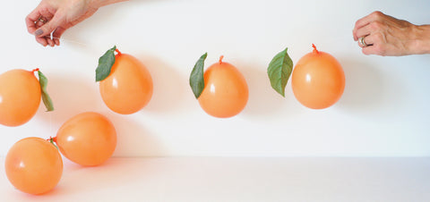 peach balloon garland with leaves