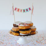 Donut birthday cake with cake topper