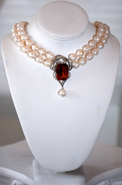 Fresh water pearls 3 row Necklace With Cognac zirconia center pendant