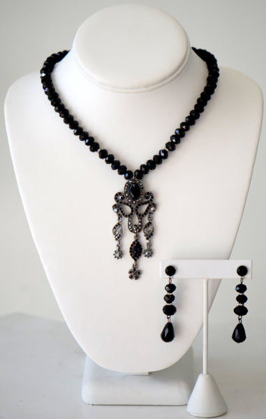 Black beaded necklace with pendant and matching earrings
