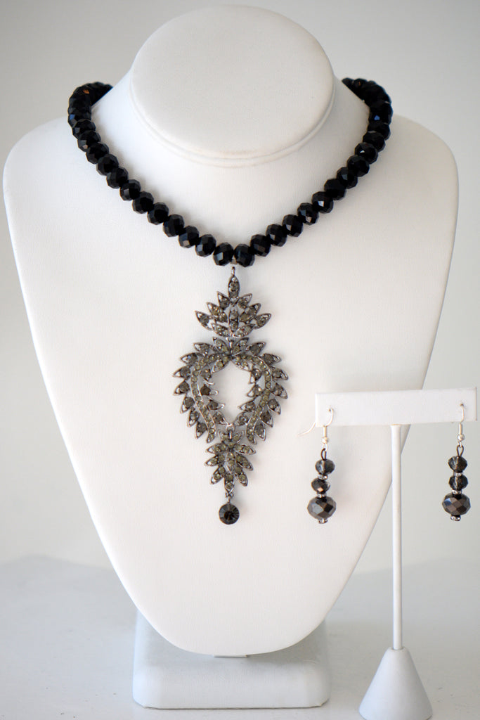 Black beaded necklace with fractal pendant