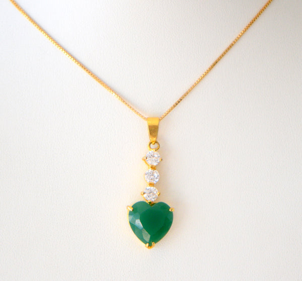 Gold chain with green heart shaped gem