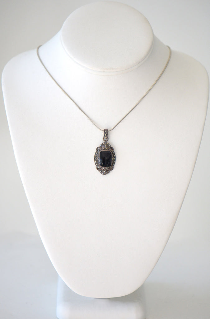Chain with black gem pendant