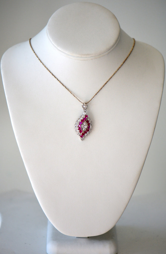 Gold chain with pink and crystal pendant