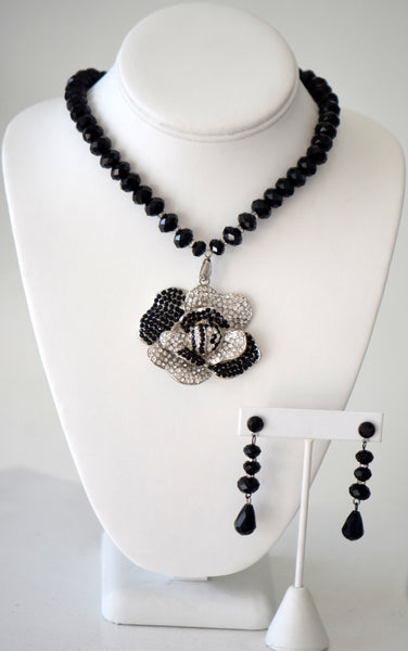 Black beaded necklace with floral pendant