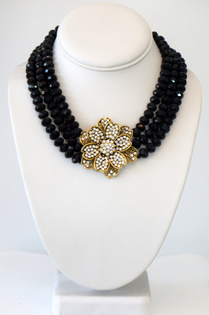 Heftsi Black Crystal 3 row necklace With Gold Plated Flower Center pieces