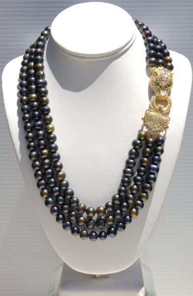Theodora - Heftsi Black Fresh water pearls 3 row necklace with gold plated side clasp