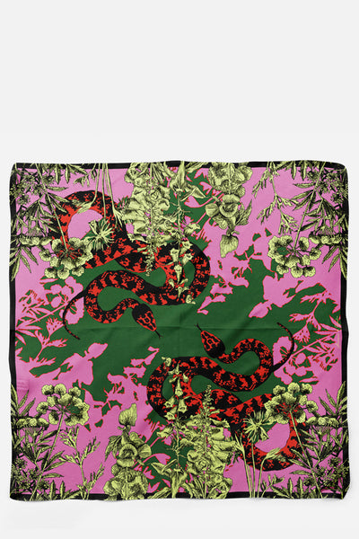 This is our Blake Snake Flower silk scarf from Harper and Blake's Venomous collection. The bold maximalist design has a pink, red, yellow and green colour pallet.