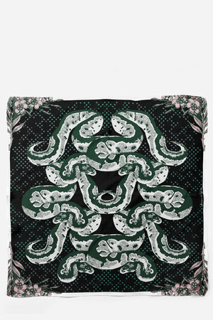 This is our Harper Snake Flower Silk Scarf. The luxurious accessory has a colour pallet of black, green, white and pink.