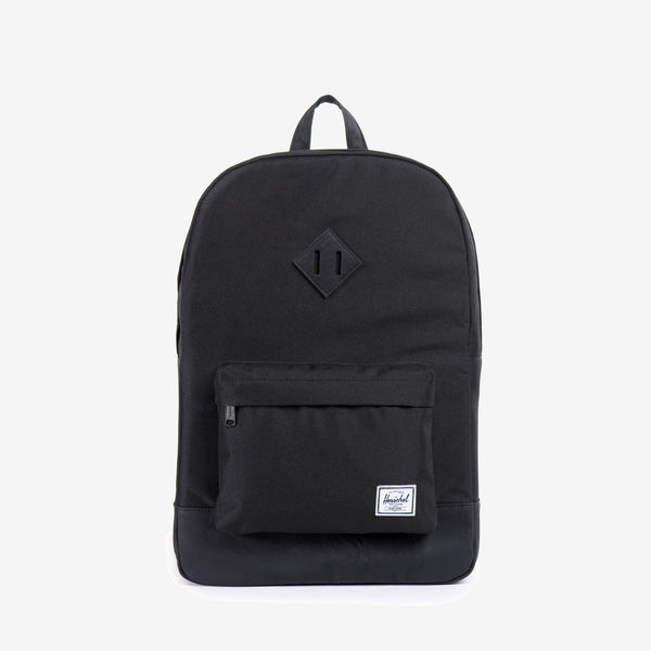 "Featuring a timeless diamond shaped accent, the Heritage backpack in Black/Black from Herschel offers a functional design and a fine regard for detail. Signature striped fabric liner 15"" laptop sleeve Front storage pocket with key clip Internal side pocket Product code: 10007.00535.OS off the hook oth streetwear boutique canada montreal"