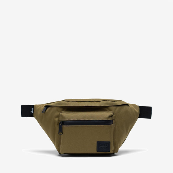 """Featuring a waterproof zipper detailed front storage pocket and an ample main compartment, the versatile Seventeen hip pack in Khaki Green from Herschel can be worn around the waist or over the shoulder. 6.5""""(H) x 13""""(W) x 3.5""""(D) Signature striped fabric liner Front storage pocket with waterproof zipper and key clip Clip-fastened adjustable webbing strap Product code: 10017.03884.OS off the hook oth streetwear boutique canada montreal quebec"""