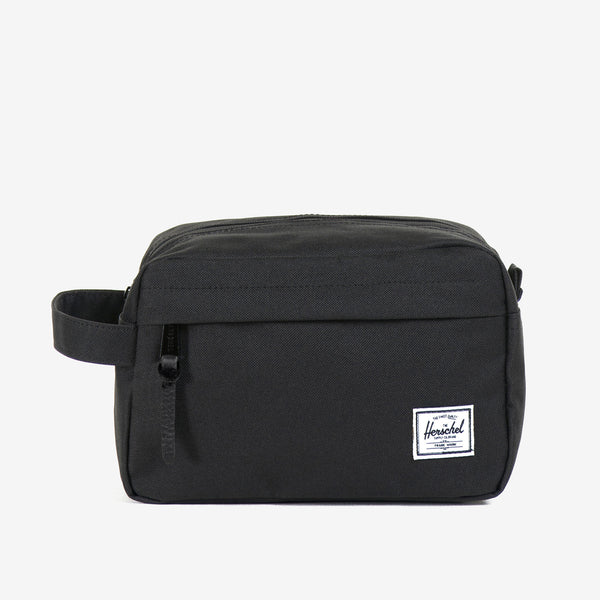 "Ideal for organizing everyday items, the Chapter travel kit in Black from Herschel features a convenient carrying handle and a waterproof zipper detailed main storage compartment.  6""(H) x 9.5""(W) x 4.5""(D) Striped fabric liner Internal mesh storage sleeve Waterproof zipper detailed main compartment Front storage pocket with pebbled leather pull Product code: 10039.00001.OS  off the hook oth streetwear boutique canada montreal quebec"