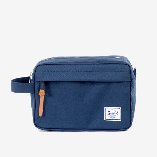 "Ideal for organizing everyday items, the Chapter travel kit in navy from Herschel features a convenient carrying handle and a waterproof zipper detailed main storage compartment.  6""(H) x 9.5""(W) x 4.5""(D) Striped fabric liner Internal mesh storage sleeve Waterproof zipper detailed main compartment Front storage pocket with pebbled leather pull Product code: 10039.00007.OS off the hook oth streetwear boutique canada montreal quebec"