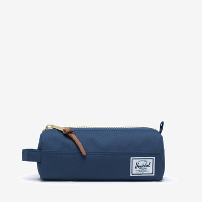 "Inspired by a classic pencil case design, the Settlement Case in Navy from Herschel features an exposed metal zipper and a convenient carrying handle.  2.75""(H) x 8""(W) x 2.5""(D) Signature striped fabric liner Product code: 10071.02546.OS off the hook oth streetwear boutique canada montreal quebec"