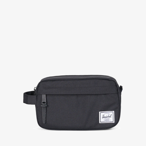 "Perfectly sized for carrying in-flight essentials, the compact Chapter Carry On travel kit in Black from Herschel features a convenient carrying handle and an internal mesh storage sleeve.  5.2"" (H) x 8.5"" (W) x 3.2"" (D) Striped fabric liner Internal mesh storage sleeve Waterproof zipper detailed main compartment Front storage pocket with pebbled leather pull Product code: 10347.00001.OS off the hook oth streetwear boutique canada montreal"