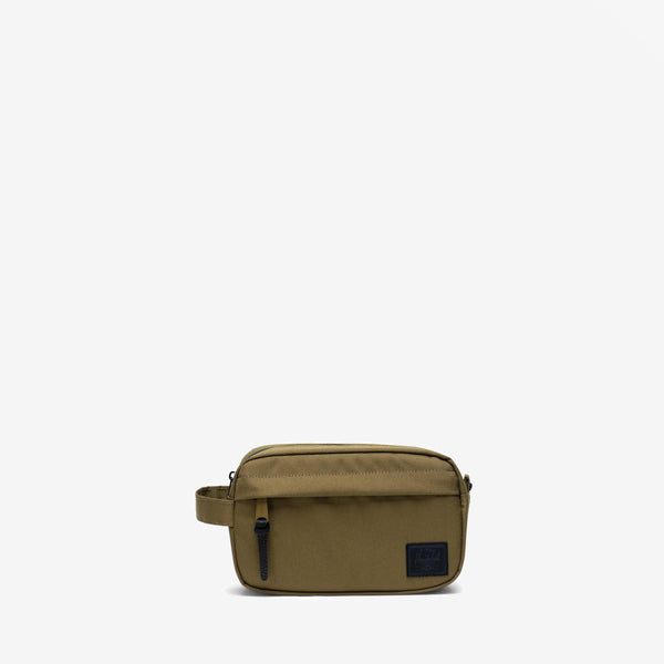 "Perfectly sized for carrying in-flight essentials, the compact Chapter Carry On travel kit in Khaki Green from Herschel features a convenient carrying handle and an internal mesh storage sleeve.  5.2"" (H) x 8.5"" (W) x 3.2"" (D) Striped fabric liner Internal mesh storage sleeve Waterproof zipper detailed main compartment Front storage pocket with pebbled leather pull Product code: 10347.03884.OS off the hook oth streetwear boutique quebec"