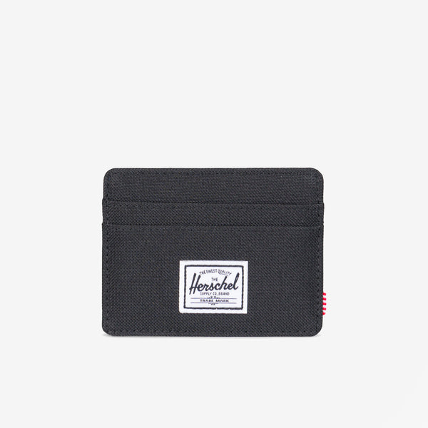 "Featuring a timeless design, the Charlie+ wallet in Black from Herschel is a compact and convenient card holder.  3""(H) x 4""(W) Signature striped fabric liner / RFID blocking layer Multiple card slots and top-access storage sleeve Engineered red and white striped tab Product code: 10360.00001.OS off the hook oth streetwear boutique canada montreal"