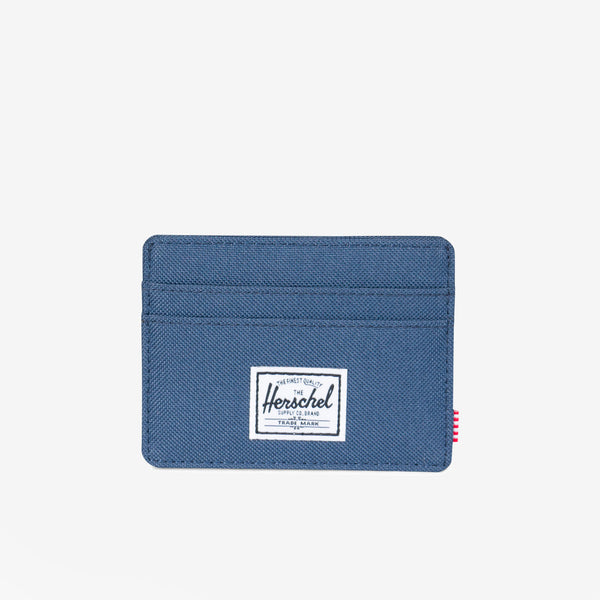 "Featuring a timeless design, the Charlie+ wallet in Navy from Herschel is a compact and convenient card holder.  3""(H) x 4""(W) Signature striped fabric liner / RFID blocking layer Multiple card slots and top-access storage sleeve Engineered red and white striped tab Product code: 10360.00007.OS off the hook oth streetwear boutique canada montreal quebec"