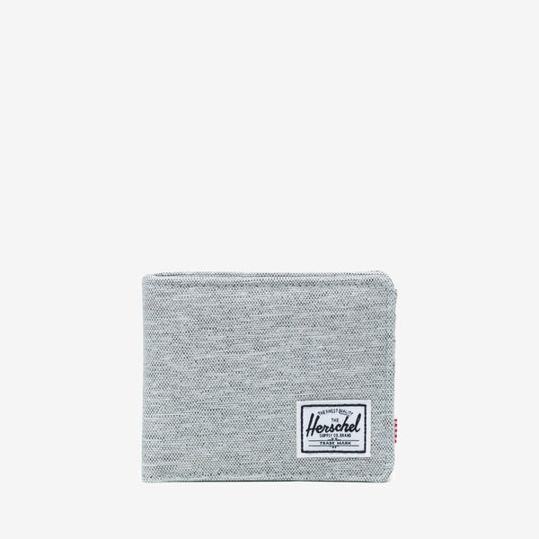 "The timeless bi-fold Roy wallet in Light Grey Crosshatch from Herschel offers a currency sleeve, multiple card slots and additional storage.  3.5""(H) x 4.4""(W) x 0.5""(D) Signature striped fabric liner / RFID blocking layer Multiple card slots Engineered red and white striped tab Product code: 10363.03884.OS off the hook oth streetwear boutique canada montreal quebec"