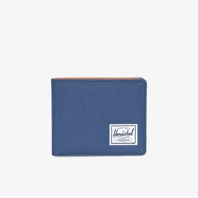 "The highly utilitarian bi-fold Hank wallet in Navy from Herschel features multiple storage options and a mesh identification window.  3.5""(H) x 4.4""(W) x 0.5""(D) Signature striped fabric liner / RFID blocking layer Synthetic leather interior Multiple card slots Currency sleeve and additional storage Mesh identification window Engineered red and white striped tab Product code: 10368.00882.OS  off the hook oth streetwear boutique canada montreal quebec"