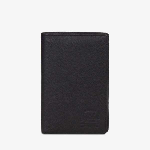 "travel documents organized and accessible, the Search Leather passport holder from Herschel in Black Pebble features a pen holder and multiple storage options. Dimensions: 6""(H) x 3.5""(W) High quality leather Black tonal striped fabric liner / RFID blocking layer Passport sleeve and pen loop Multiple card slots and storage sleeves Debossed classic logo Product code: 10396.01885.OS off the hook oth streetwear boutique canada montreal quebec"