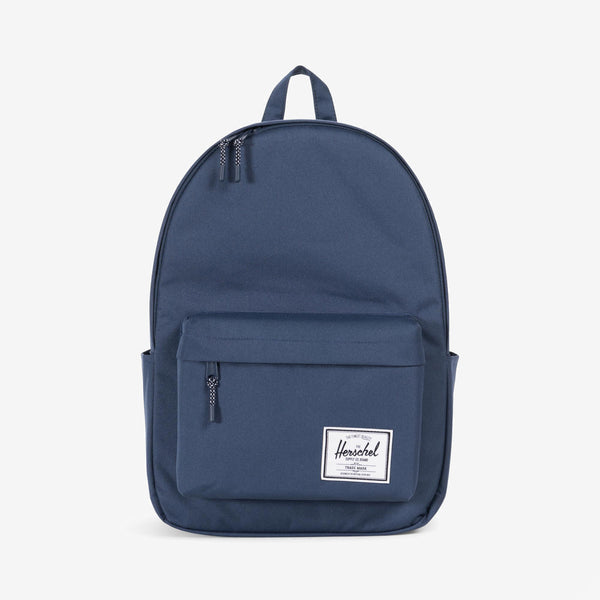 "Offering enhanced storage volume and water bottle pockets, the cleanly designed Classic XL backpack in Navy from Herschel is a versatile and timeless style with functional details. Signature striped fabric liner 15"" laptop sleeve Front storage pocket with key clip Prusik cord zipper pulls Dual water bottle pockets Classic woven label Product code: 10492.00007.OS off the hook oth streetwear boutique canada montreal quebec"