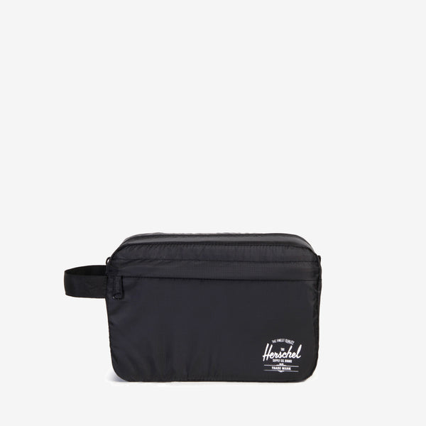 The lightweight Standard Issue Toiletry Bag in Black from Herschel keeps essentials organized in your check-in or carry-on luggage, and conveniently folds away when not in use. Internal self-storage pocket with snap closure Zippered main compartment closure Front storage pocket Screen printed classic logo and Standard Issue branding Product code: 10533.00001.OS off the hook oth streetwear boutique canada montreal quebec