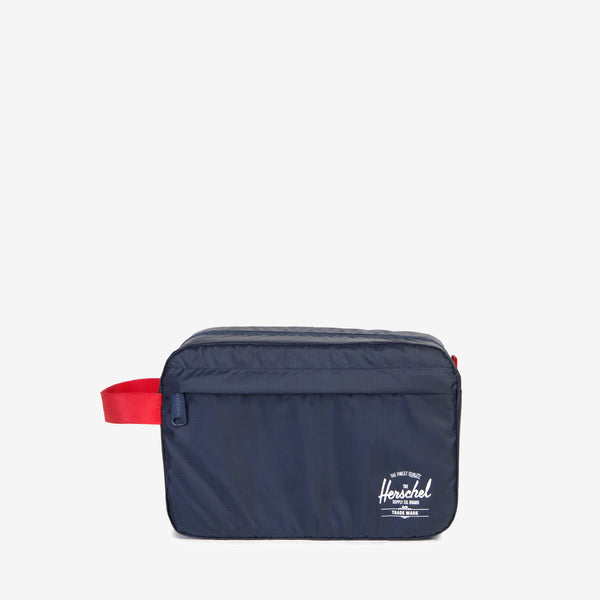 The lightweight Standard Issue Toiletry Bag in Navy from Herschel keeps essentials organized in your check-in or carry-on luggage, and conveniently folds away when not in use. Poly ripstop fabric Internal self-storage pocket with snap closure Zippered main compartment closure Front storage pocket Screen printed classic logo and Standard Issue branding Product code: 10533.00018.OS off the hook oth streetwear boutique canada montreal quebec