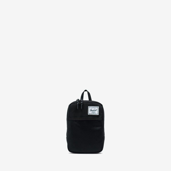 """Offering storage for small digital accessories and other essentials, the Sinclair Large crossbody in Black from Herschel features multiple carrying options, including a removable strap and a belt loop. 7.5""""(H) x 5""""(W) x 1.75""""(D), 1.5L Signature striped fabric liner Internal storage sleeve Two-way zippered closure with Prusik cord pulls Mesh front storage sleeve Product code: 10567.00001.OS off the hook oth streetwear boutique canada montreal quebec"""