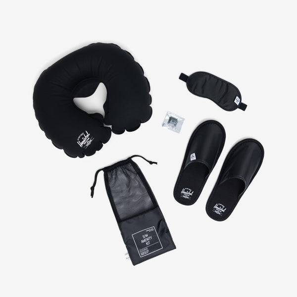 Accompanied by a convenient storage pouch, the Standard Issue Amenity Kit in Black from Herschel includes ear plugs, a sleeping mask, slippers and an inflatable neck pillow for maximum in-flight comfort. off the hook oth streetwear boutique canada montreal