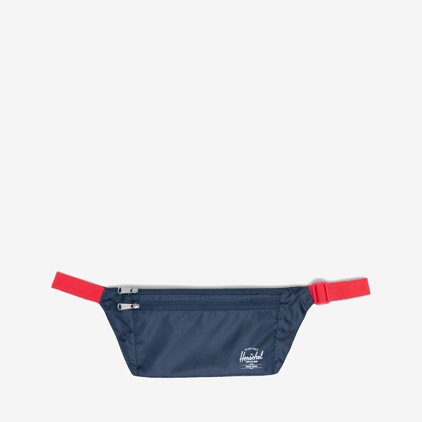 The adjustable Standard Issue Explorer Pouch in Navy from Herschel is a hip pack style that keeps currency and cards both hidden and accessible. Ripstop fabric Adjustable clip-fastened waistband Zippered storage sleeves Product code: 10686.00018.OS off the hook oth streetwear boutique canada montreal quebec