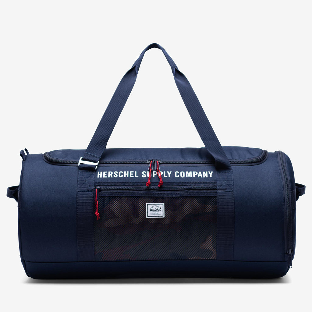 "The Trail Sutton Carryall duffle in navy camo from Herschel is equipped with handles that convert into backpack straps, signature shoe U-shaped opening. 2"" (H) x 24"" (W) x 12"" (D) U-shaped zippered closure with underside storage External center pocket with concealed zipper Hook-convertible carrying handles / backpack straps Rear luggage trolley strap Side utility handles Oversized signature shoe compartment Product code: 10699.03102.OS off the hook oth streetwear boutique canada montreal"