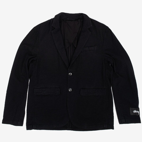 The Seersucker Sport Coat in Black offers a casually refined look from the streetwear titan. It comes in a tailored fit, with a Stock Logo woven label on sleeve. Two front flap pockets, chest pocket and interior welt pocket add practicality.  100% Cotton Woven Horn buttons at center front closure and sleeves Product code: 115513 off the hook oth streetwear boutique canada montreal canada