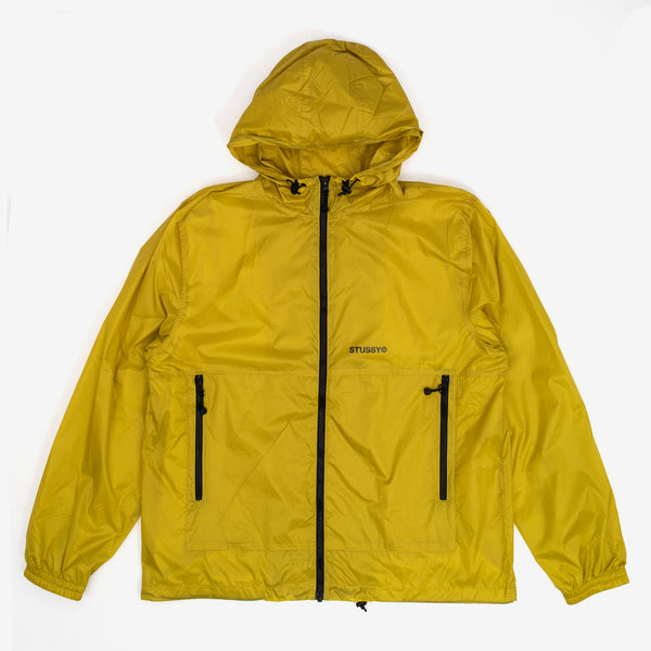 The Tech Ripstop Jacket in Yellow from Stussy features a hood with Stussy custom zip pulls throughout. Adjustable hood and hem. Mesh lined. Elastic cuff and Stussy screenprint on front left panel.  100% Nylon Woven  Product code: 115514 off the hook oth streetwear boutique canada montreal
