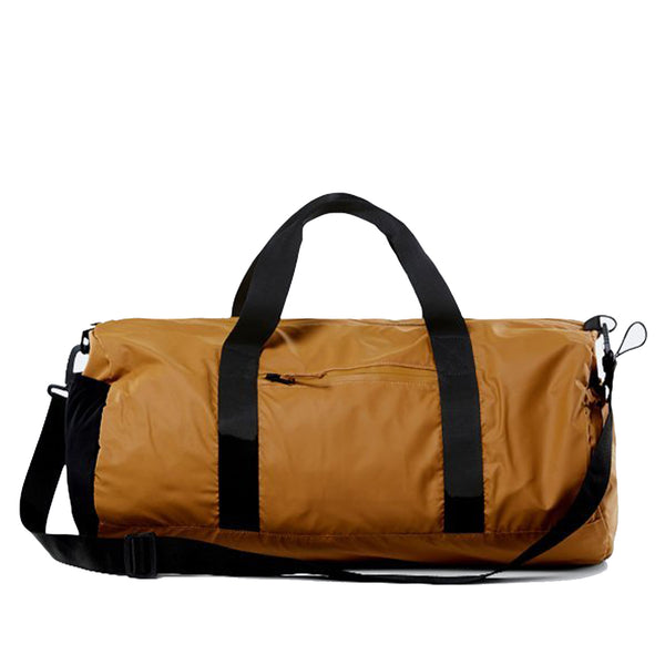 This is a duffel crafted from ultralightweight, waterproof PU featuring a main zipper compartment, a front pocket for easy access and a side-elastic mesh sleeve. It has two top handles, as well as a crossbody strap for multi-functional carrying options. off the hook oth streetwear boutique canada montreal rains bag 1348 camel beige