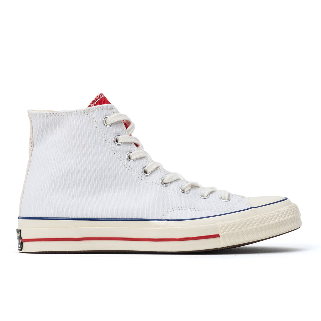 These Chuck 70s have all the classic features – durable 12 oz canvas, winged stitching for reinforcement and vintage branding. But this time, Converse colorblocked the tongue.  Canvas high top sneakers. Chuck Taylor ankle patch. Product code: 166826C   white university red egret off the hook oth streetwear shoes sneakers boutique canada montreal