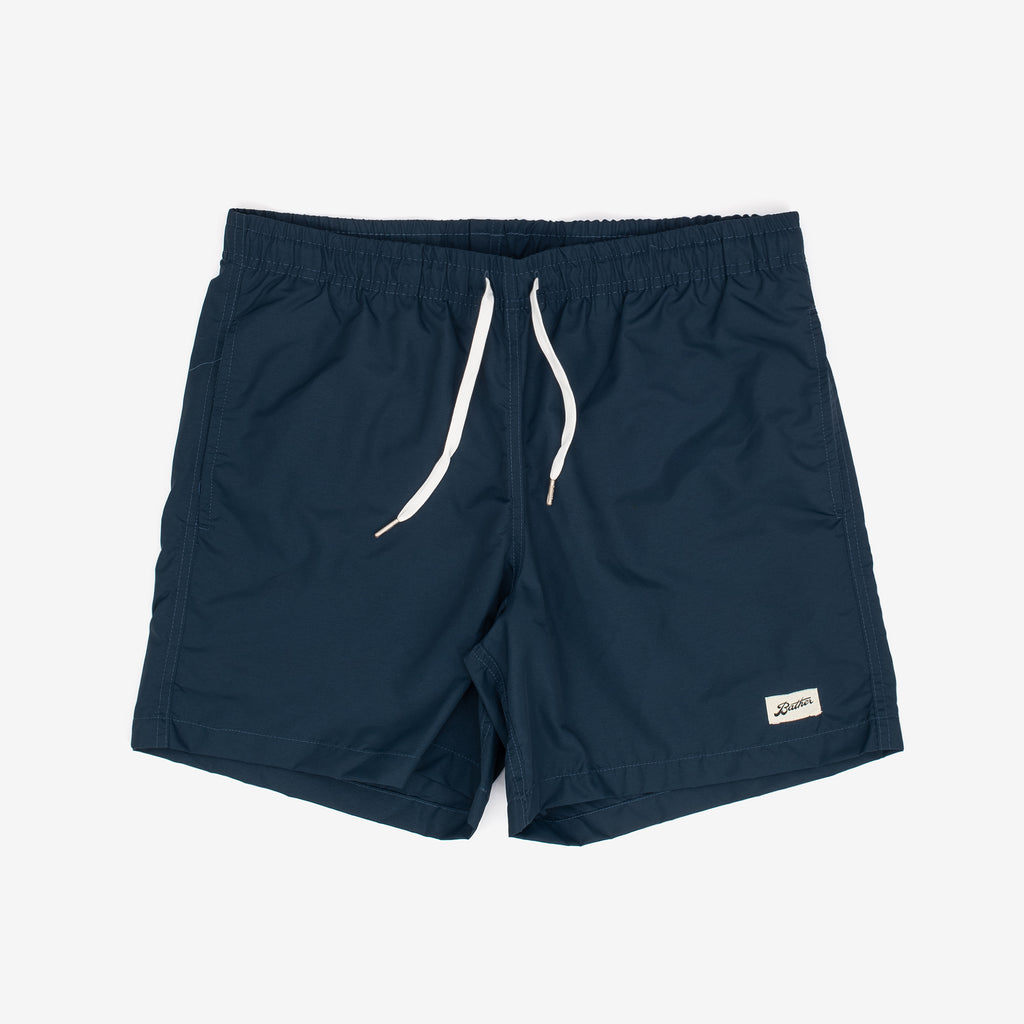 These swim trunks from Bather feature contrasting drawstrings and are adorned with a logo patch. They also boast an elasticised waist, custom tipped drawstrings, along with a quick-dry shell.   Shell: 100% Nylon Quick Dry Lining: 90% Nylon 10% Spandex Ultra Fine Mesh Reinforced Side Pockets Back Pocket With Snap Enclosure 5.5 Inch Inseam Made in Canada Product code: 20400-NVY off the hook oth streetwear boutique canada montreal