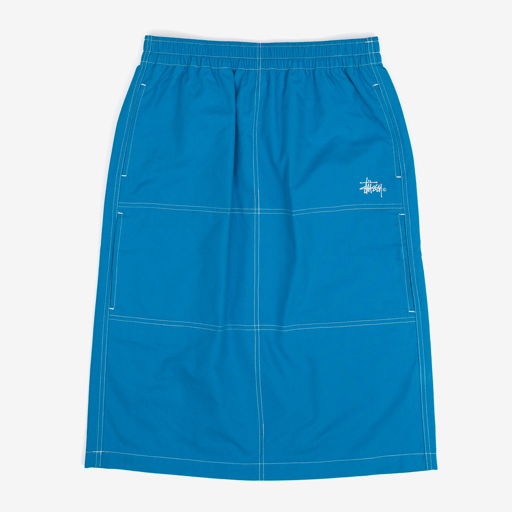 The Minimal Cargo Skirt in Blue has a straight fit, features 4 discreet pockets on the front and contrast stitching throughout. Embroidered logo over the front left pocket.  This item is displayed in Women's sizing 70% / 30% Cotton/Nylon Woven Product code: 211190 off the hook oth streetwear boutique canada montreal