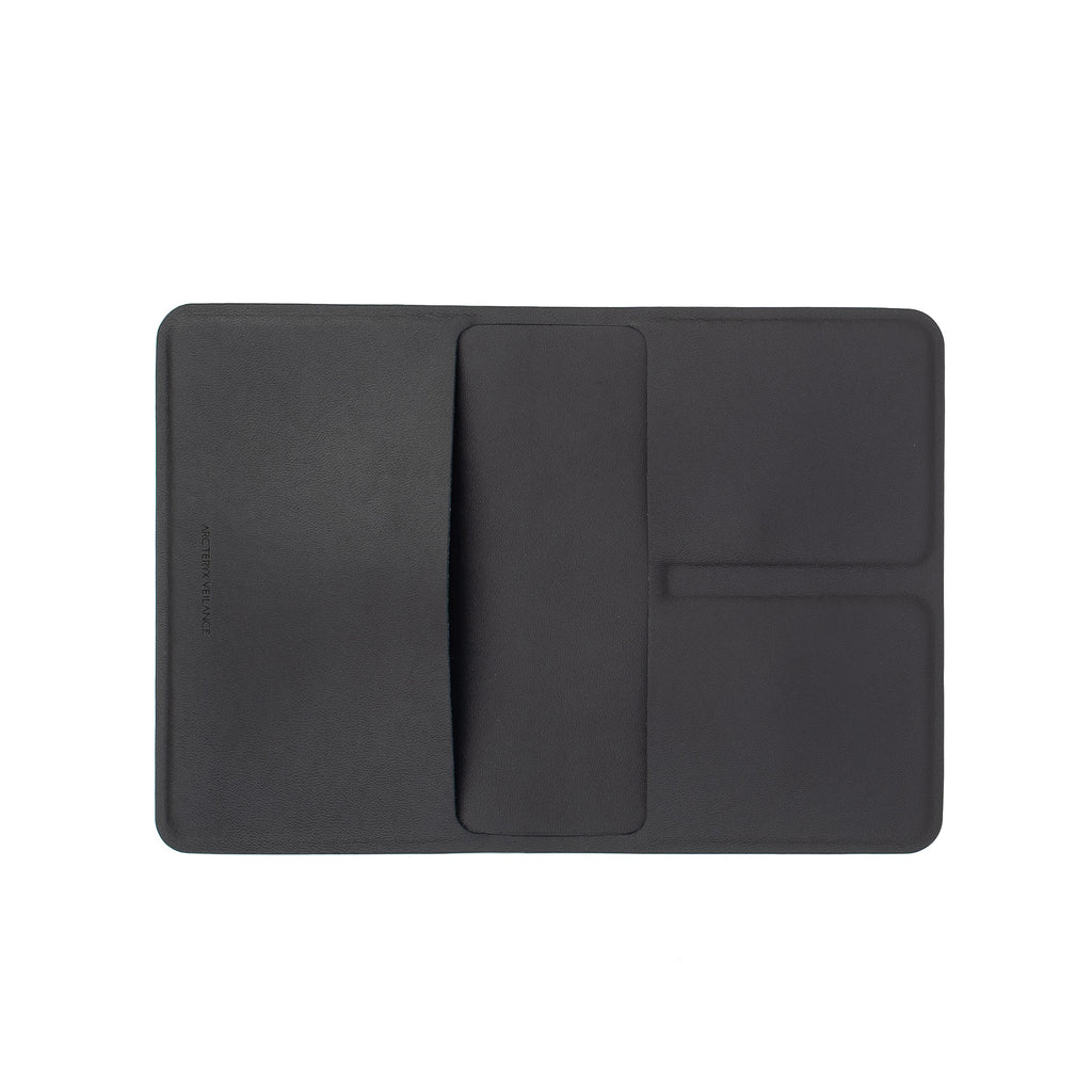 Smooth durable passport wallet is designed using proprietary stitchless construction, resulting in ultra slim leather goods.  Weight: 56 g / 2 oz Product code: 23858 Basing Passport Wallet Black off the hook oth streetwear boutique canada montreal tech techwear accessory arcteryx veilance