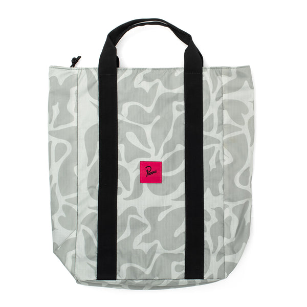 Water resistant nylon ripstop fabric with a custom allover print. Back side compartment with removable shoulder straps, so it can be used as a backpack. Inner laptop compartment and zippered compartment for keys and wallet. Pink woven Parra label at front.  Tote bag measuring 17.7 x 11.8 x 5.1 inches Product code: 43590 by parra bird camo off the hook oth streetwear boutique accessory canada
